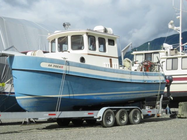 26' NORDIC TUG SPORT TUG, 66 HP YANMAR, BIG COCKPIT, TRIPLE AXLE TRAILER. ASKING $74,500
