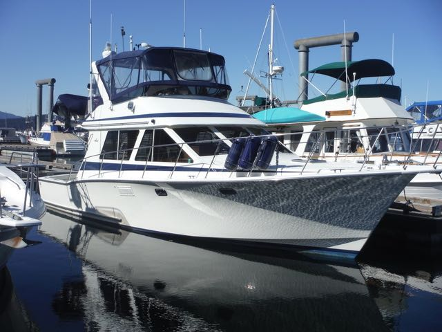 40' TOLLYCRAFT CONVERTIBLE SPORT SEDAN, TWIN DETROIT'S, 3 STATION CONTROLS.  HURRY! $159,900